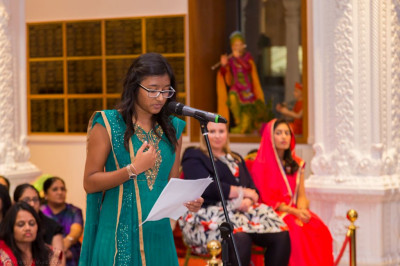 A young disciple addresses the assembly summarising the many charitable achievements attained by Shree Swamianrayan Mandir Kingsbury