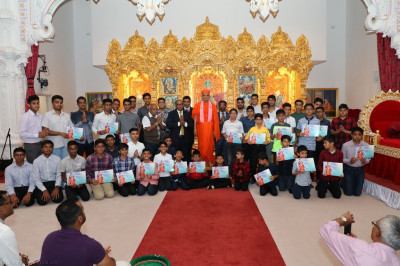 His Divine Holiness Acharya Swamishree blesses all award winners, teachers, assistants and everyone associated with Shree Muktajeevan Swamibapa Academy of Excellence
