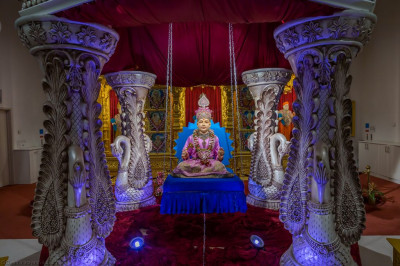 Divine darshan of Lord Shree Swaminarayan seated on the swing