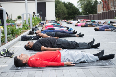All perform savasana as the International Yoga day class concludes