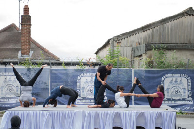 "Various yoga poses to form the word  ""YOGA "" at the conclusion of the event"