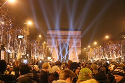 Crowds gather at the famous Arc De Triomphe at the centre of Paris on new year's eve