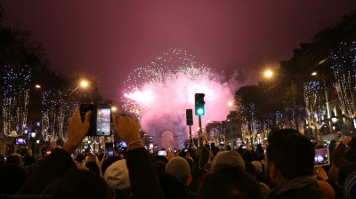 Spectacular fireworks light up the Paris night sky near the famous Arc De Triomphe on new year's eve