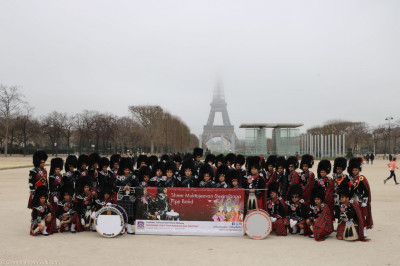 Shree Muktajeevan Swamibapa Pipe Band Bolton and London in front of the Eiffel Tower