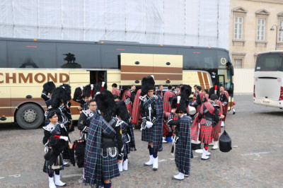 Shree Muktajeevan Swamibapa Pipe Band London and Bolton arrive at the start of the Grande Parade in the Champs-Elysees