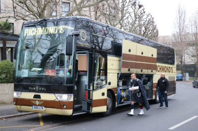 The coach arrives at the start of the New Year's day parade in Paris