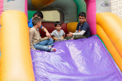 Young disciples enjoy the bouncy castle and slides