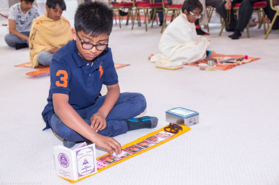Young disciples perform pooja taking part in the pooja workshop