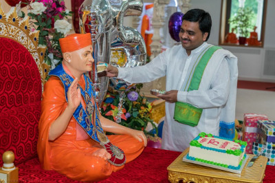 Cake is offered to His Divine Holiness Acharya Swamishree