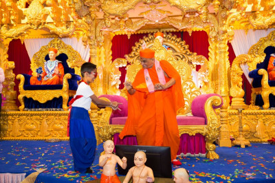 His Divine Holiness Acharya Swamishree dances with a young disciple
