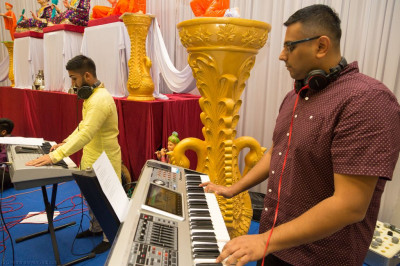 Disciples perform devotional songs during raas