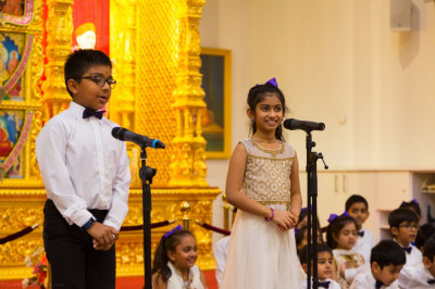 Disciples of the lower school of Swamibapa Gujarati Classes perform an assembly with a kirtan performance to please Lord Shree Swaminarayan