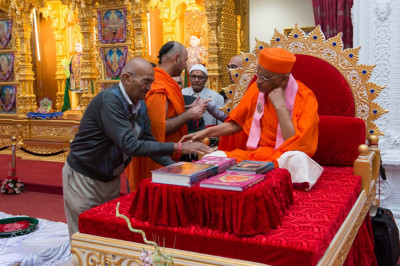 His Divine Holiness Acharya Swamishree presents rakhadi to all disciples later in the evening