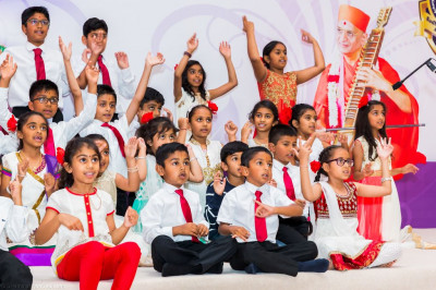 Disciples of Shree Muktajeevan Swamibapa Gujarati School perform a devotional song with hand actions