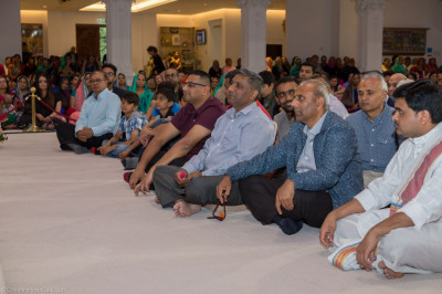 Disciples and honoured guests enjoy the concert