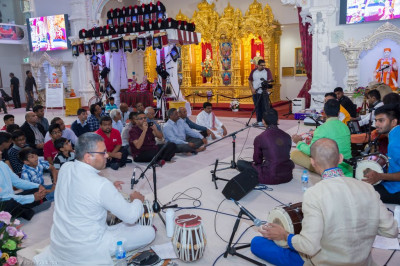 Disicples and talented musicians perform a total of seven devotional songs and a dhoon