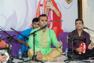 Shree Aditya Shah, disicples and talented musicians perform a total of seven devotional songs and a dhoon