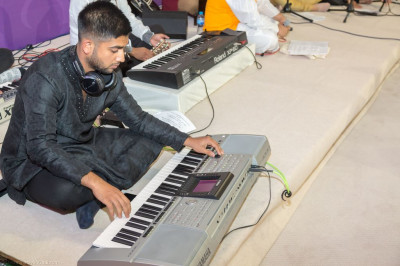 Disciples and talented musicians perform devotional songs