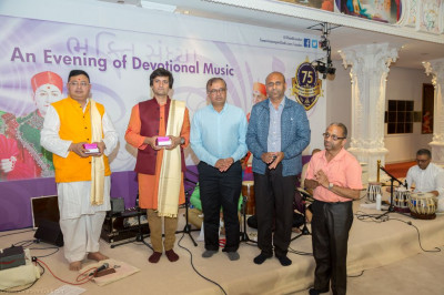 Disciples present prasad shawl and prasad to Shree Aditya Shah and honoured performers