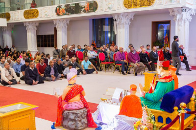 Disciples fill Shree Swaminarayan Mandir Kingsbury and follow the Shikshapatri recital on the screen, devices or their own personal copies