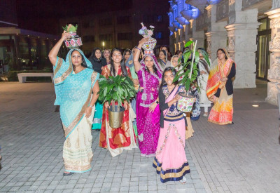Disciples carry Vasent Poojan items