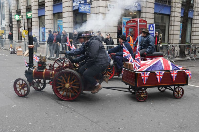 A steam powered vehicle takes part in the parade
