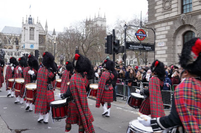 Shree Muktajeevan Swamibapa Pipe Band London perform in the London New Year's Day Parade marching past Westminster station
