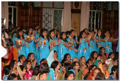 Disciples take part during the finale of the Raas