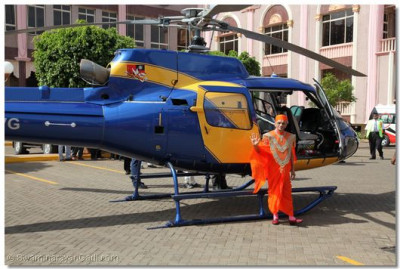 Divine darshan of His Divine Holiness Acharya Swamishree next to the helicopter at Shree Swaminarayan Temple Nairobi