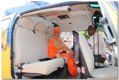 His Divine Holiness Acharya Swamishree boards the helicopter at Shree Swaminarayan Temple Nairobi