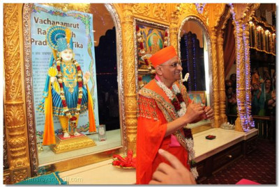 The Divine Darshan of His Divine Holiness Acharya Swamishree in front of the grand Sinhasan at Shree Swaminarayan Temple Naiorbi