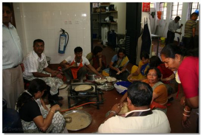 Disciples prepare maha-prasad lunch and dinner