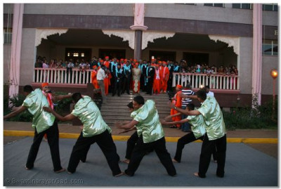 Disciples perform a traditional dance just outside H.H. Swamibapa Hall