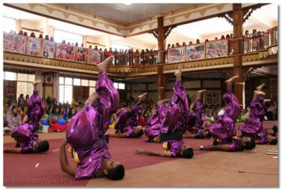 Young disciples perform an energetic dance as part of the finale to please Lord Swaminarayanbapa Swamibapa