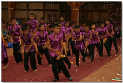 Young disciples perform a dance as part of the finale to please Lord Swaminarayanbapa Swamibapa
