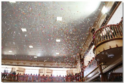 Confetti cannons are continously launched and bubbles are blown across Shree Swaminarayan Temple Nairobi amist the celebrations