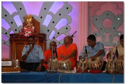 Devotee sings kirtans during the performances