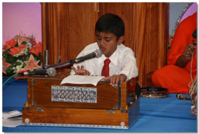 A young devotee performing
