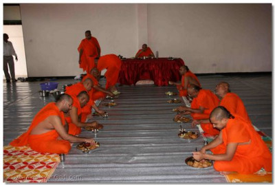 Acharya Swamishree and sants have some prasad lunch