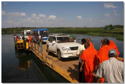 The tour group on their way to Paraa Lodge cross a river on a ferry