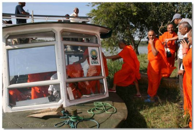 Acharya Swamishree boards the river boat