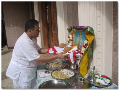 The flag being blessed by Lord Swaminarayanbapa Swamibapa