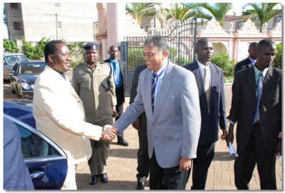 Prime Minister Raila Odinga welcomed by a committee member
