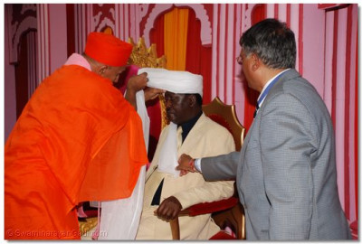 Saint ties a Turban to the Chief Guest