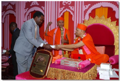 Guest presented with prasad