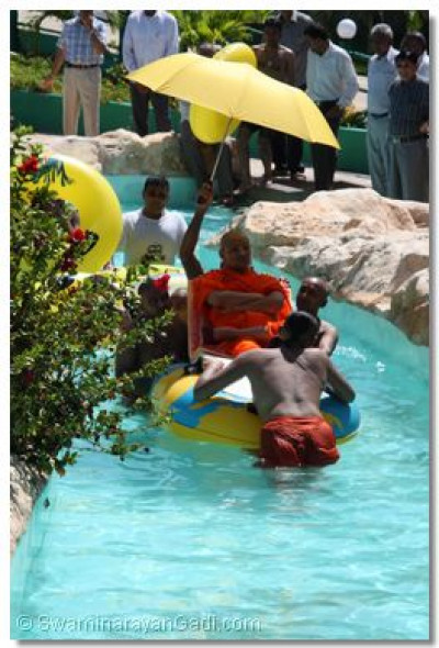 Acharya Swamishree boating at Wild Water Slides