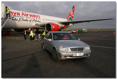 Acharya Swamishree driven to the VIP lounge from Kenya Airways aircraft