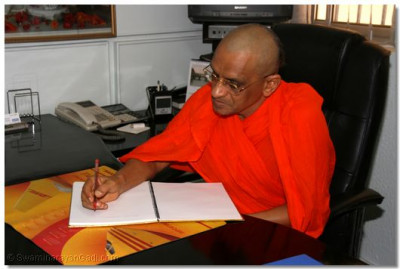 Acharya Swamishree autographs in a visitor's book