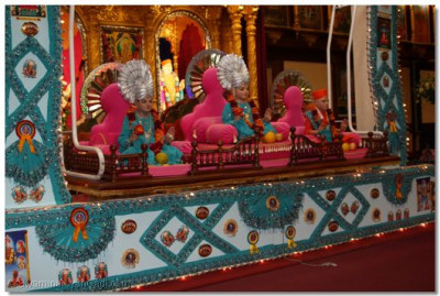 Sarees and other regalia items beautifully displayed on the hindola