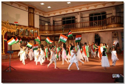 Devotees march proudly with the Indian National flag